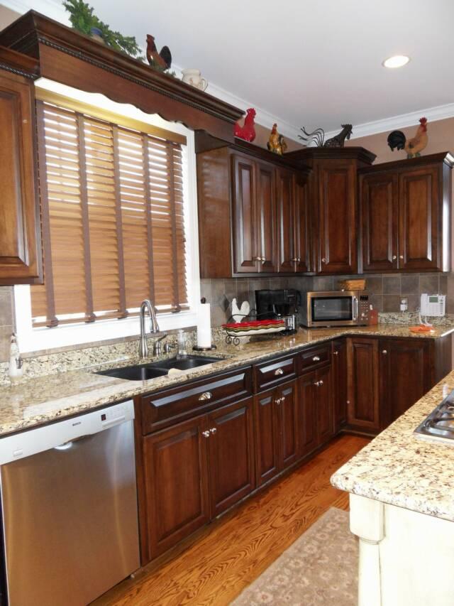 Dark stain on staggered height cherry kitchen cabinets